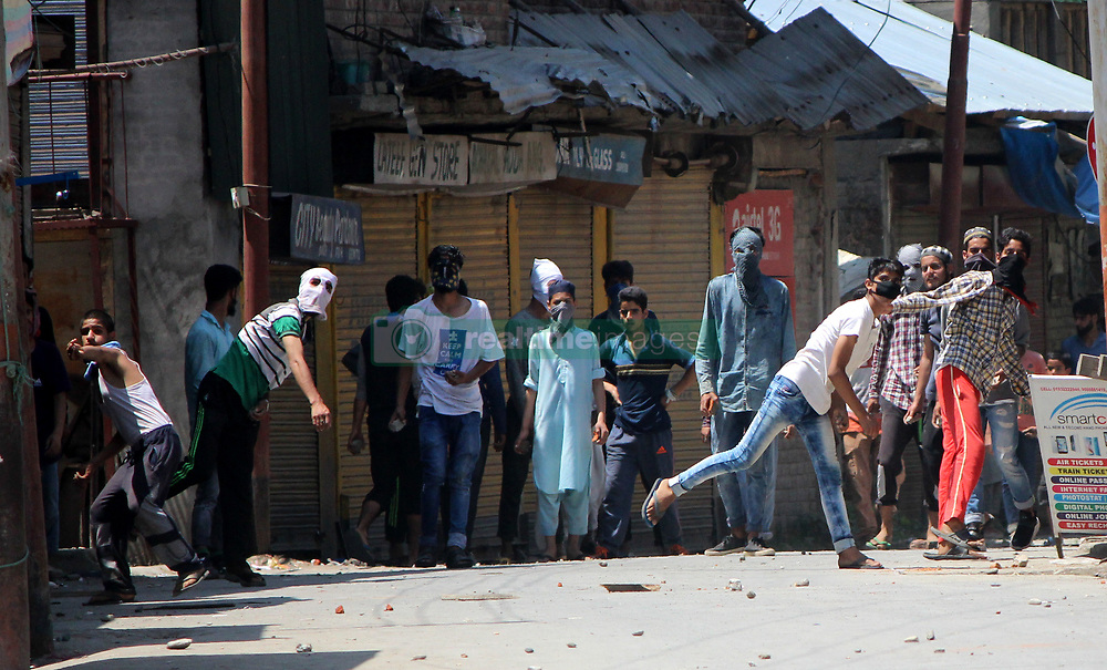 August 4, 2017 - Anantnag, Jammu & Kashmir, India - Intense clashes erupted in main town Anantnag immediately after a local Rebel Yawar was laid to rest at his ancestral graveyard. Hundreds of youth pelted stones on government forces to vent their anger against the killing of this local rebel. (Credit Image: © Muneeb Ul Islam/Pacific Press via ZUMA Wire)