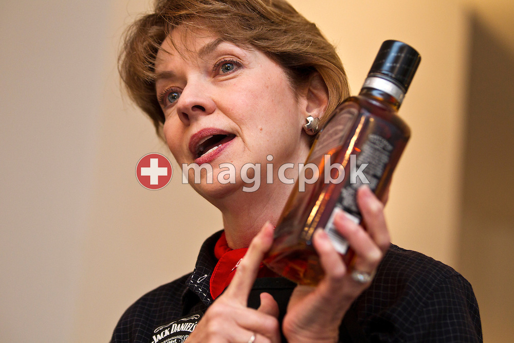 Lynne Tolley holds a bottle of Jack Daniel's Gentleman Jack while talking during a whiskey tasting event with Jack Daniel's great-grandniece, Lynne Tolley held at the Cookook in Zurich, Switzerland, Thursday, Sept. 30, 2010. (Photo by Patrick B. Kraemer / MAGICPBK)