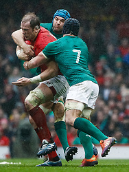 Alun Wyn Jones of Wales is tackled by Tadhg Beirne of Ireland<br /> <br /> Photographer Simon King/Replay Images<br /> <br /> Six Nations Round 5 - Wales v Ireland - Saturday 16th March 2019 - Principality Stadium - Cardiff<br /> <br /> World Copyright © Replay Images . All rights reserved. info@replayimages.co.uk - http://replayimages.co.uk