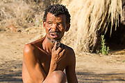 Bushman, Kalahari Desert, Namibia. The Bushmen are indigenous people of southern Africa that span areas of South Africa, Zimbabwe, Lesotho, Mozambique, Swaziland, Botswana, Namibia, and Angola. Bushmen were traditionally hunter-gatherers but began to switch to farming in the 1950s. Genetic evidence suggests they are one of the oldest, if not the oldest, peoples in the world, from which all humans can ultimately trace their genetic heritage.