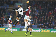 Fulham defender Cyrus Christie (22) leaps for the header with 3 Charlie Taylor for Burnley FC during the Premier League match between Burnley and Fulham at Turf Moor, Burnley, England on 12 January 2019.