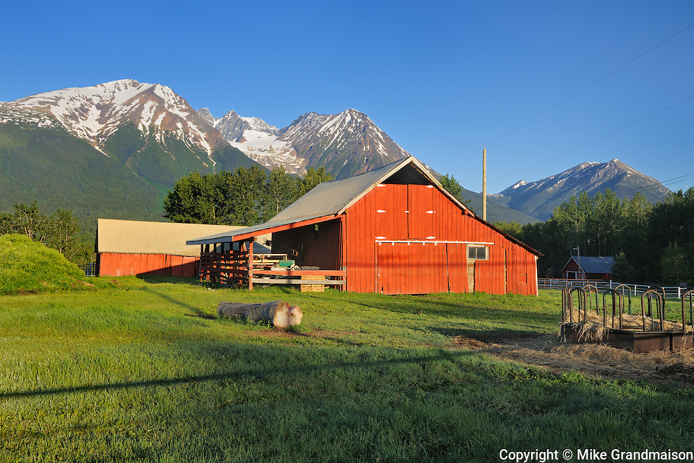 Red barn and Coast Mountains<br /> Smithers<br /> British Columbia<br /> Canada