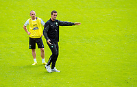 02/07/14<br /> CELTIC TRAINING<br /> AUSTRIA<br /> Celtic's Scott Brown (left) watches manager Ronny Deila give out instructions and pre-season training