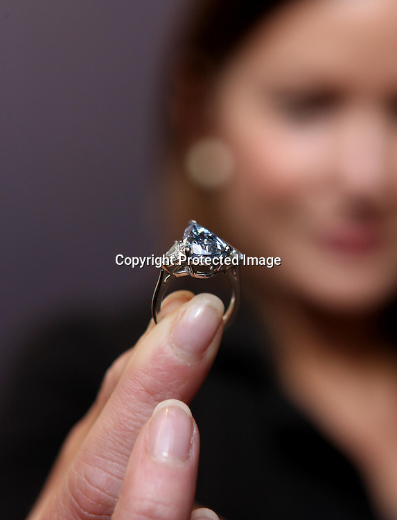 SOTHEBY'S EMPLOYEE RHONDA YUNG MODELS THE DE BEERS MILLENIUM BLUE DIAMOND.THE FIRST MILLENIUM BLUE DIAMOND TO APPEAR AT AUCTION.THE DIAMOND IS 5.16 CARAT, PEAR SHAPED AND INTERNALLY FLAWLESS AND IS VALUED AT US$4.6-5.8 MILLION.8.3.10.PIX STEVE BUTLER