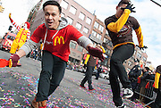 Members of the McDonald's team dance down the street during the 2014 Lunary New Year parade. Photo by Natalie Fertig/NYCity Photo Wire