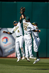 OAKLAND, CA - APRIL 17:  Coco Crisp #4 of the Oakland Athletics, Josh Reddick #22 and Billy Burns #1 celebrate after the game against the Kansas City Royals at the Oakland Coliseum on April 17, 2016 in Oakland, California.  The Oakland Athletics defeated the Kansas City Royals 3-2. (Photo by Jason O. Watson/Getty Images) *** Local Caption *** Coco Crisp; Josh Reddick; Billy Burns