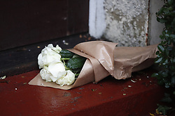 © Licensed to London News Pictures. 05/12/2018. London, UK. Flowers are left on the doorstep of  a house in north London where a 77 year old woman has died after a burglary. The victim called Police to her address on Bells Hill around 6. 00pm yesterday, after two suspects forced entry and stole her property. During the phone call to the 999 operator the woman collapsed. She died in hospital this morning. Photo credit: Peter Macdiarmid/LNP