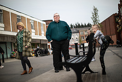 © Licensed to London News Pictures . 18/04/2019. Farnworth , UK . PETER FLITCROFT (55 from Harper Green)  , leader of Farnworth and Kearsley First (centre) and his wife MAUREEN FLITCROFT (56) (left) , in newly pedestrianised Farnworth Town Centre as their grandchildren play . Independent political parties , not tied to existing national parties , are competing for council seats in wards across the North West . Photo credit : Joel Goodman/LNP