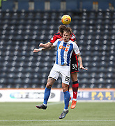 23rd September 2017, Rugby Park, Kilmarnock, Scotland; SPFL Premiership football, Kilmarnock versus Dundee; Dundee's Kerr Waddell and Kilmarnock's Lee Erwin compete in the air