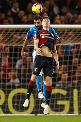 November 11, 2018 - Genoa, Italy - Krzysztof Piatek (R) of Genoa and Raul Albiol of Napoli vie for a header during the Lega Seria A match between Genoa CFC and SSC Napoli on November 10, 2018 at Stadio Luigi Ferraris in Genoa, Italy. (Credit Image: © Mike Kireev/NurPhoto via ZUMA Press)