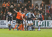 James McPake in agony after sustaining a serious injury, Dundee United&rsquo;s Ryan McGowan signals for assistance - Dundee v Dundee United, Ladbrokes Premiership at Dens Park<br /> <br />  - &copy; David Young - www.davidyoungphoto.co.uk - email: davidyoungphoto@gmail.com