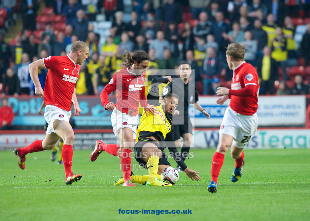 Diego Poyet of Charlton Athletic tries to get the ball from Mathias Ranegie of Watford during the Sky Bet Championship match at The Valley, London<br /> Picture by Alan Stanford/Focus Images Ltd +44 7915 056117<br /> 29/04/2014