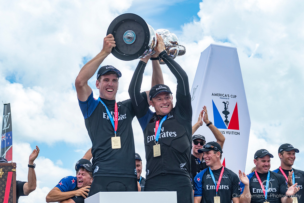 The Great Sound, Bermuda, 26th June 2017. Emirates Team New Zealand Helmsman Peter Burling and skipper Glenn Ashby hold aloft the America's Cup.
