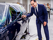 15 APRIL 2019 - DES MOINES, IOWA: JULIÁN CASTRO looks at 1988 Pontiac Grand Prix that is being restored in the Skilled Trades Alliance auto shop during Castro's visit to the Central Campus Skilled Trades Alliance at the Des Moines Public School's Central Campus Monday. Castro is on his third visit to Iowa since declaring his candidacy for the Democratic ticket of the US Presidency. Casto talked to students and administrators about skilled trades education and toured the campus. Iowa traditionally hosts the the first selection event of the presidential election cycle. The Iowa Caucuses will be on Feb. 3, 2020.                PHOTO BY JACK KURTZ
