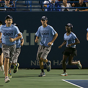 August 21, 2014, New Haven, CT:<br /> Ball kids run onto the court during the Men's Legends Event on day seven of the 2014 Connecticut Open at the Yale University Tennis Center in New Haven, Connecticut Thursday, August 21, 2014.<br /> (Photo by Billie Weiss/Connecticut Open)