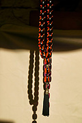 Red and black amber Worry beads or komboloi, kompoloi a string of beads manipulated with one or two hands and used to pass time in Greek and Cypriot culture. Unlike the similar prayer beads used in many religious traditions, worry beads have no religious or ceremonial purpose.