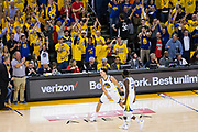 Golden State Warriors guard Klay Thompson (11) celebrates a made basket against the Houston Rockets during Game 6 of the Western Conference Finals at Oracle Arena in Oakland, Calif., on May 26, 2018. (Stan Olszewski/Special to S.F. Examiner)