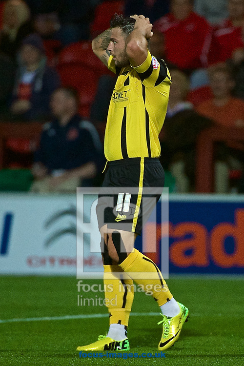 Dale Jennings of Barnsley is disappointed after missing a chance during the Sky Bet League 1 match at the Highbury Stadium, Fleetwood<br /> Picture by Ian Wadkins/Focus Images Ltd +44 7877 568959<br /> 17/09/2014