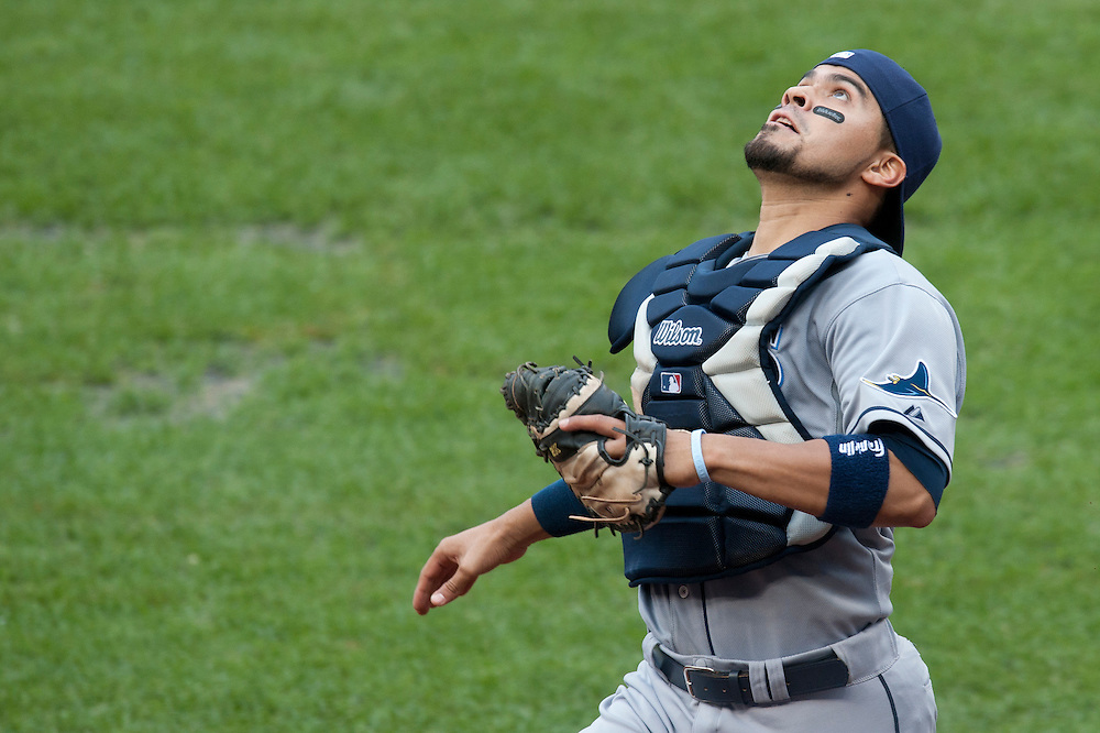 NEW YORK - AUGUST 13: Robinson Chirinos #38 of the Tampa Bay Rays attempts to catch a pop-up during the game against the New York Yankees at Yankee Stadium on August 13, 2011 in the Bronx borough of Manhattan. (Photo by Rob Tringali) *** Local Caption *** Robinson Chirinos