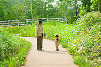 A young boy and his grandfather enjoy a day out at one of Sapporo's most popular parks.