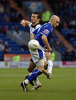 Photo: Kevin Poolman.<br />Leicester City v Fulham. The FA Cup. 06/01/2007. Fulham's Tomasz Radzinski and Danny Tiatto of Leicester clash.