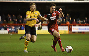 Lyle Della-Verde and Mark Byrne battle for posession during the Sky Bet League 2 match between Crawley Town and Newport County at the Checkatrade.com Stadium, Crawley, England on 1 March 2016. Photo by Michael Hulf.