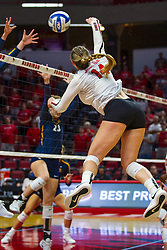 BLOOMINGTON, IL - September 15: Monica Miller hits the ball towards Elizabeth Orf during a college Women's volleyball match between the ISU Redbirds and the Marquette Golden Eagles on September 15 2019 at Illinois State University in Normal, IL. (Photo by Alan Look)