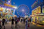 Rides and other attractions light up the night sky Saturday in the Midway at the Nebraska State Fair in Grand Island. (Independent/Matt Dixon)