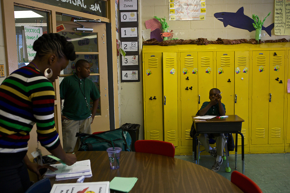Third grader Marquet Williams, right, and other students await instruction from their teacher Courtney Jackson, left, at Adelaide Davis Elementary School on Nov. 26, 2012 in Washington, D.C. Last week DCPS Chancellor Kaya Henderson proposed closing 20 under-enrolled schools in the District. Davis Elementary is one of 20 schools in the DCPS system included in the school closure proposal. There are currently 178 students enrolled in Davis Elementary and the second floor of the school is only used for music classes and the library...CREDIT: Lexey Swall for The Wall Street Journal.DCSCHOOLS