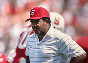 BERKELEY, CA - 1989:  Dennis Green, Stanford University Head Coach, watches from the sidelines during a Stanford Cardinal football game played in 1989 at Stanford Stadium in Palo Alto, California.