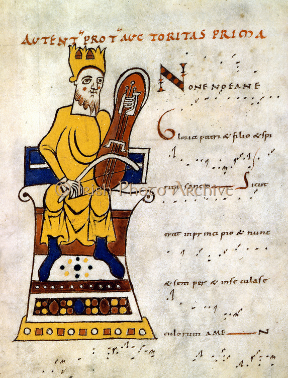 King David playing a 'lyre'. 10th-11th century manuscript of St Martial de Limoges. Probably a Rebec (Rebeck) 3-stringed instrument developed from Arab Rabab. Bibliotheque Nationale.
