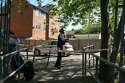 © Licensed to London News Pictures. 19/05/2020. London, UK. Police officer guards the crime scene on Wiltshire Gardens in Haringey, north London as police launch an investigation following a fatal shooting. Police were called just after 10pm on Monday 18 May to reports of shots fired in Wiltshire Gardens. Police attended and found a mon, believed to be in his 20s, suffering gunshots injuries. The victim was pronounced dead at the scene.  Photo credit: Dinendra Haria/LNP