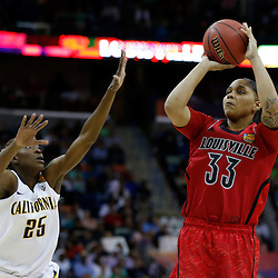 April 7, 2013; New Orleans, LA, USA; Louisville Cardinals forward Monique Reid (33) shoots against California Golden Bears forward Gennifer Brandon (25) during the second half in the semifinals during the 2013 NCAA womens Final Four at the New Orleans Arena. Mandatory Credit: Derick E. Hingle-USA TODAY Sports