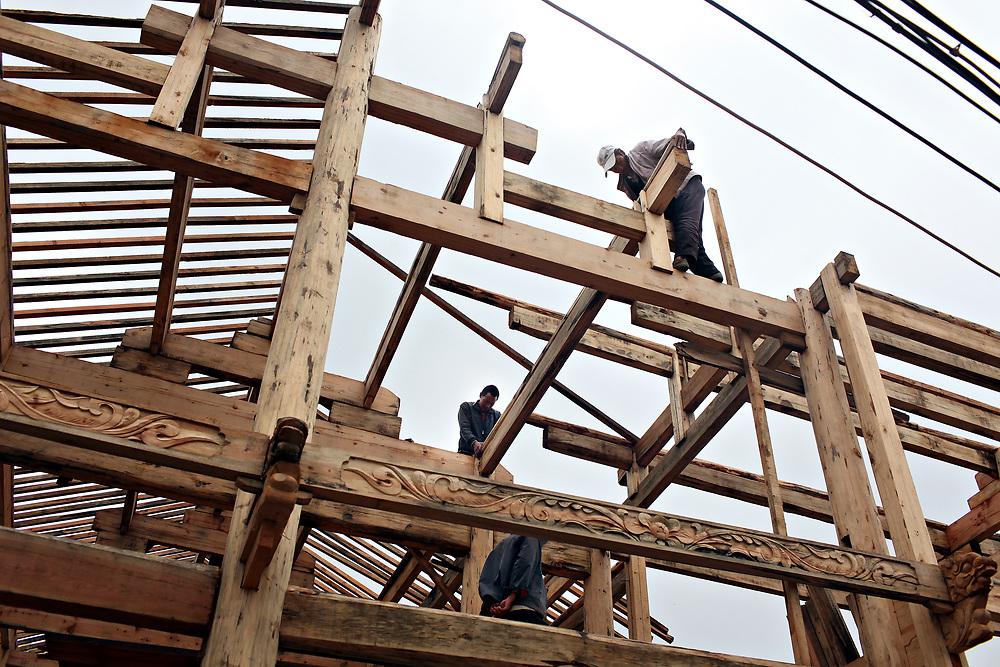 Building a traditional Naxi guest house, Lijiang, Yunnan, China; September, 2013.