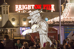 © Licensed to London News Pictures. 19/12/2017. Brighton, UK. Members of the public take part in the 2017 Burning the Clocks parade through Brighton city centre organised by Same Sky. Photo credit: Hugo Michiels/LNP