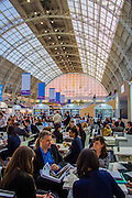 The Penguin Random House stand. Discussions, negotiations and deals go on at tables all over the fair. London Book Fair, Olympia, London, UK, 14 Apr 2015.