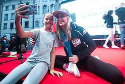 Janja Garnbret three time world champion posing for a selfie with a young fan during PZS reception after IFSC Climbing World Championships in Hachioji (JPN) 2019, on August 23, 2019 at Ministry of Education, Science and Sport, Ljubljana, Slovenia. Photo by Grega Valancic / Sportida