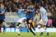 Manchester City defender Benjamin Mendy (22) and Atalanta midfielder Ruslan Malynovskyy (18) challenge for the ball  during the Champions League match between Manchester City and Atalanta at the Etihad Stadium, Manchester, England on 22 October 2019.