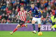 Sonny Bradley (#5) of Luton Town FC clears the ball ahead of Chris Maguire (#7) of Sunderland AFC during the EFL Sky Bet League 1 match between Sunderland AFC and Luton Town at the Stadium Of Light, Sunderland, England on 12 January 2019.