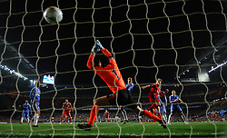 Dirk Kuyt scores the fourth goal past Chelsea's Petr Cech during the UEFA Champions League Quarter Final Second Leg match between Chelsea and Liverpool at Stamford Bridge on April 14, 2009 in London, England.