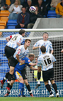Photo: Steve Bond.<br /> Shrewsbury Town v Chesterfield. Coca Cola League 2. 13/10/2007. Aaron Downes (L) rises high to clear early on