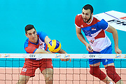 Poland, Krakow - 2017 September 03: (left) Nikola Rosic from Serbia receives the ball while Third Place match between Belgium and Serbia during LOTTO EUROVOLLEY POLAND 2017 - European Championships in volleyball  at Tauron Arena on September 03, 2017 in Krakow, Poland.<br /> <br /> Mandatory credit:<br /> Photo by &copy; Adam Nurkiewicz<br /> <br /> Adam Nurkiewicz declares that he has no rights to the image of people at the photographs of his authorship.<br /> <br /> Picture also available in RAW (NEF) or TIFF format on special request.<br /> <br /> Any editorial, commercial or promotional use requires written permission from the author of image.