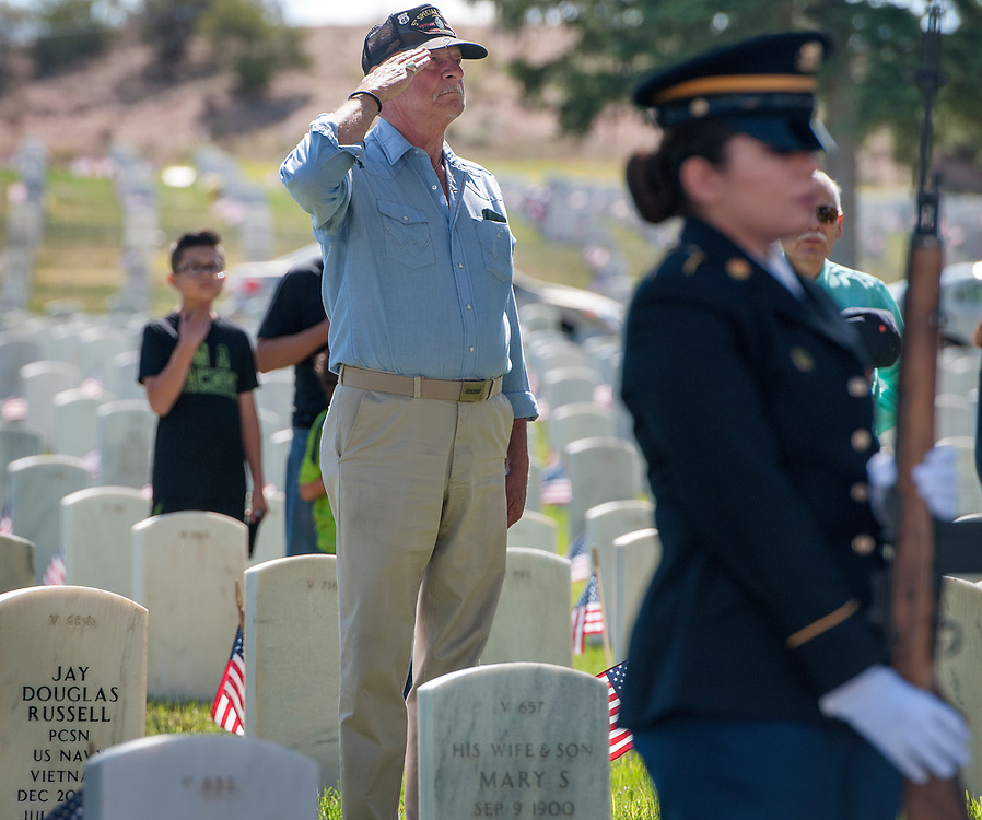 em052917d/a/Roy Garrison, from Eldorado and former U.S. Army Special Forces, salutes during presentation of the colors at the Memorial Day ceremony at the Santa Fe National Cemetery on Memorial Day, Monday May 29, 2017. The keynote speaker at the event was Alan Martinez, deputy secretary of the N.M. Dept. of Veterans Services. (Eddie Moore/Albuquerque Journal