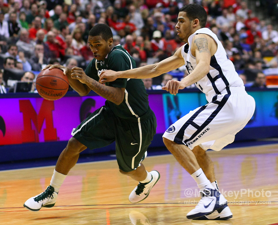 March 12, 2011; Indianapolis, IN, USA; Michigan State Spartans guard Keith Appling (11) dribbles against Penn State Nittany Lions guard Talor Battle (12)in the semi-final round of the 2011 Big Ten Tournament at Conseco Fieldhouse. Penn State defeated Michigan State 61-48. Mandatory credit: Michael Hickey-US PRESSWIRE