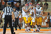 AUSTIN, TX - OCTOBER 18:  Aaron Wimberly #2 of the Iowa State Cyclones celebrates after scoring a touchdown with quarterback Sam B. Richardson #12 against the Texas Longhorns on October 18, 2014 at Darrell K Royal-Texas Memorial Stadium in Austin, Texas.  (Photo by Cooper Neill/Getty Images) *** Local Caption *** Aaron Wimberly; Sam B. Richardson