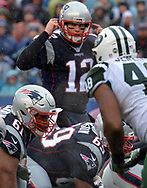 (Foxboro, MA 122416) Tom Brady calls a play in the first quarter. Staff photo Chris Christo