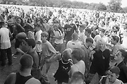 Ravers enjoying the tunes in the sunlight, Ashton Court Festival, Bristol, UK, 1995.