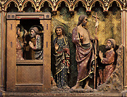 The resurrected Christ appears to Peter (left) and John (right), on the South choir screen, 1351, by Jean le Bouteiller, carved polychrome wood with 9 scenes of the apparitions of Christ after his resurrection, separated by columns, in the Cathedrale Notre-Dame de Paris, or Notre-Dame cathedral, built 1163-1345 in French Gothic style, on the Ile de la Cite in the 4th arrondissement of Paris, France. The choir screen was restored in the 19th century under Viollet le Duc. Photographed on 17th December 2018 by Manuel Cohen