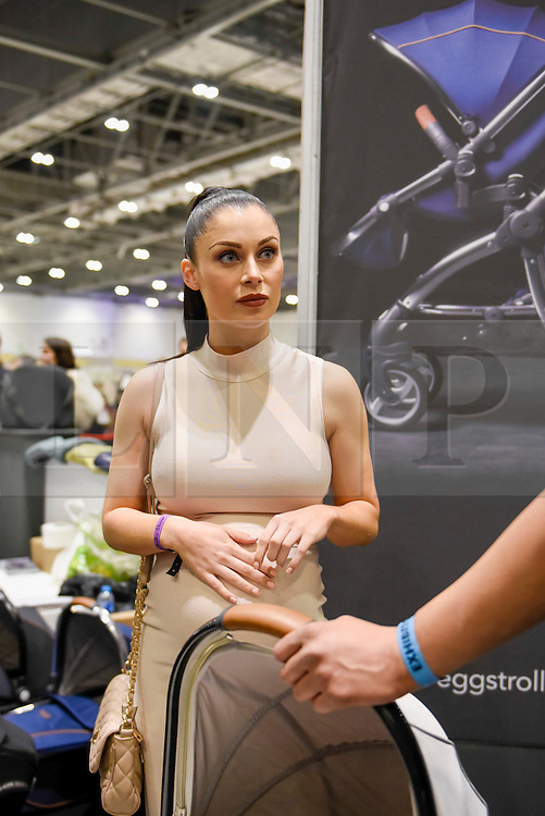"""© Licensed to London News Pictures. 05/03/2017. London, UK. Cally Jane Beech, reality TV personality from """"Love Island"""", visits the Baby Planet stand at The Baby Show at the Excel Centre in Docklands.  Baby Planet is the UK's largest independent nursery retailer, one of the 200 exhibitors presenting their products to new and expectant parents to over 24,000 visitors this weekend. Photo credit : Stephen Chung/LNP"""