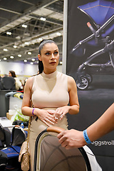 "© Licensed to London News Pictures. 05/03/2017. London, UK. Cally Jane Beech, reality TV personality from ""Love Island"", visits the Baby Planet stand at The Baby Show at the Excel Centre in Docklands.  Baby Planet is the UK's largest independent nursery retailer, one of the 200 exhibitors presenting their products to new and expectant parents to over 24,000 visitors this weekend. Photo credit : Stephen Chung/LNP"